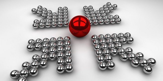 Image of four arrows pointing to a red sphere to visually represent the four ways to improve B2B social networking